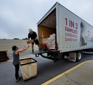 Volunteers unloading a delivery truck.